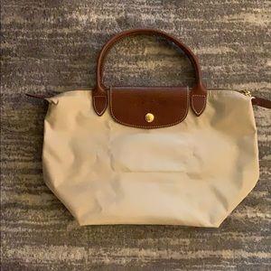 Beige medium size Longchamp bag